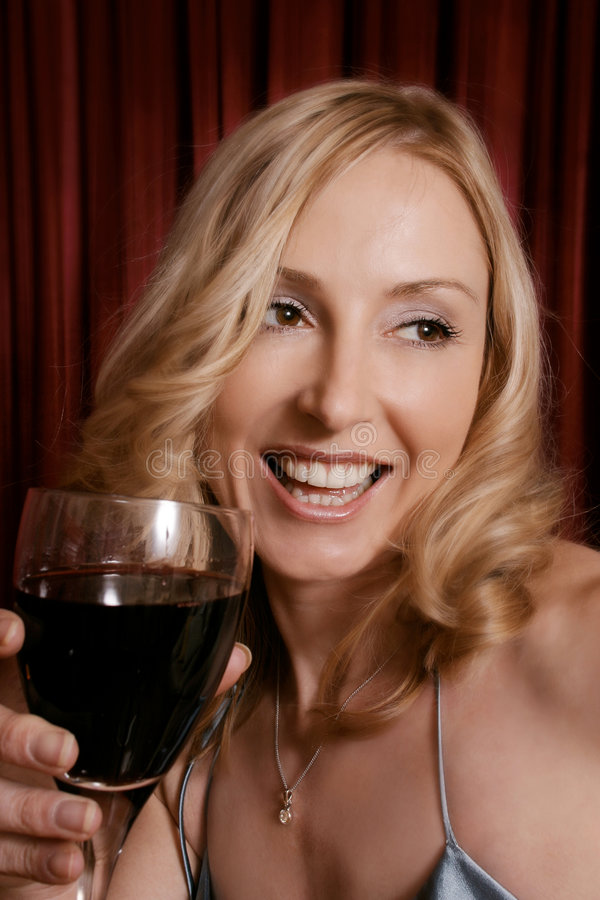 After Five. Female enjoys a glass of red royalty free stock photography