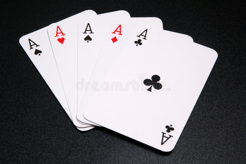 Five aces. Winning hand of five aces, on a black background royalty free stock photos