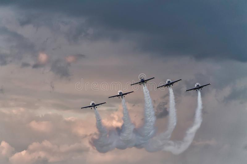 Five airplanes formation at an air show royalty free stock photography