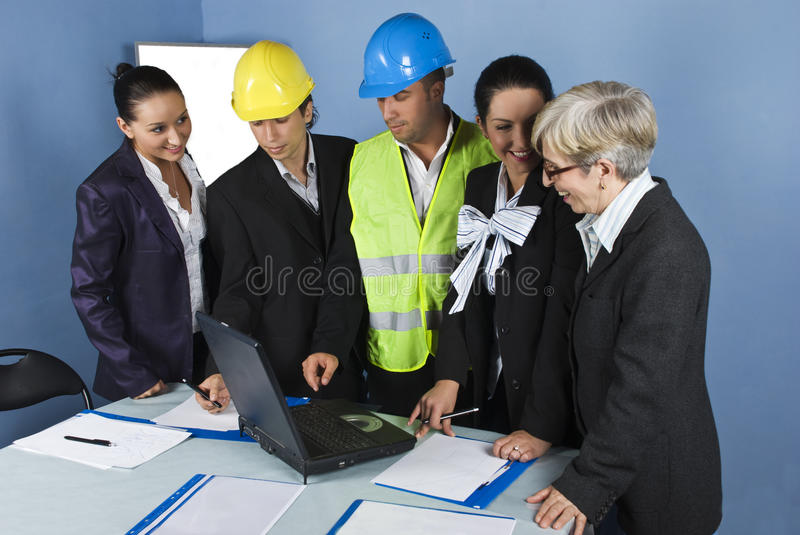 Five architects team in office working royalty free stock photography