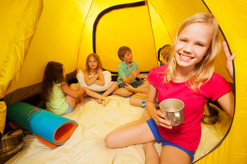 Five beautiful kids sit in a tent royalty free stock photos