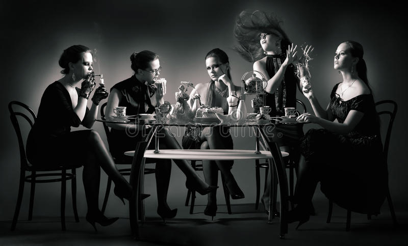 Five Beauty Girls Tea Drinking At The Table Stock Images