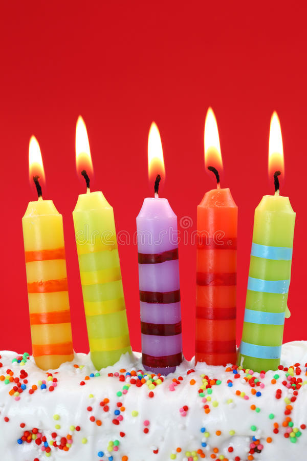 Five birthday candles. On red background royalty free stock photos