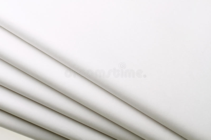 Five blank newspapers. Blank tabloid format newspaper on white background stock photos