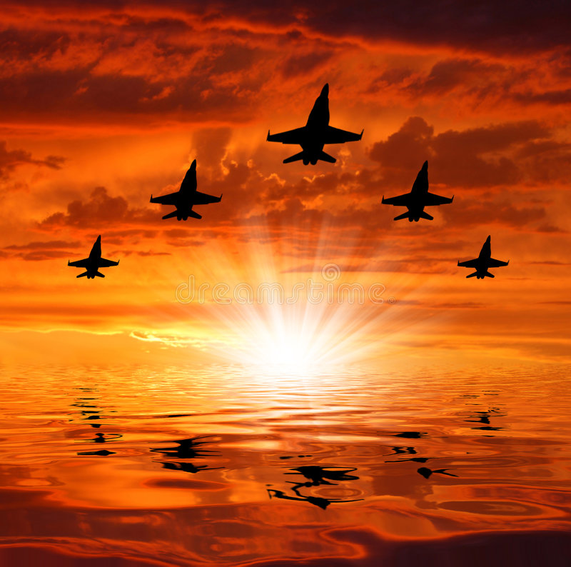 Five bombers over sunset royalty free stock image