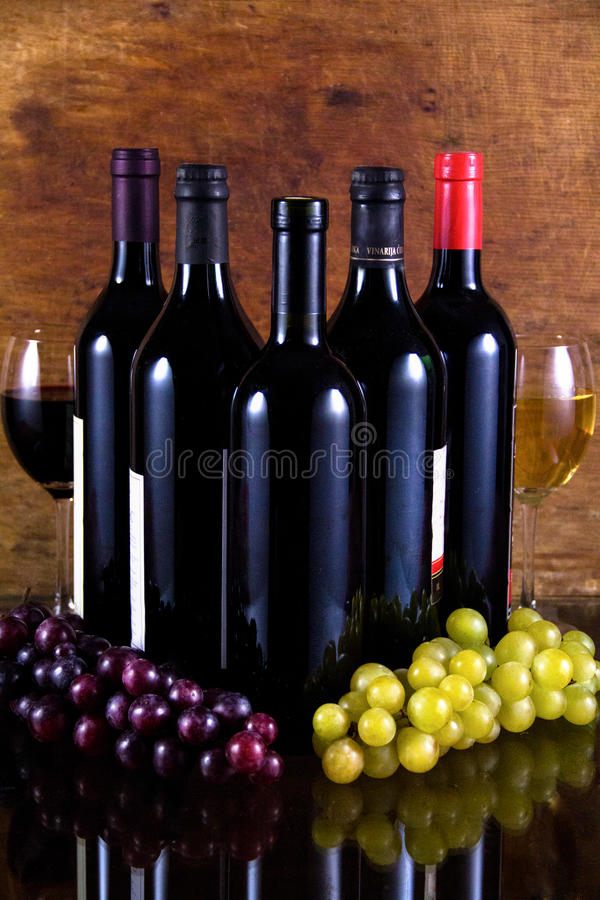 Download Five Bottles Of Wine And Two Glasses Stock Image - Image: 27016297