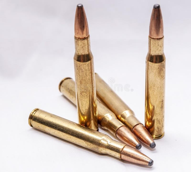 Five brass hunting bullets. On a white background royalty free stock photos