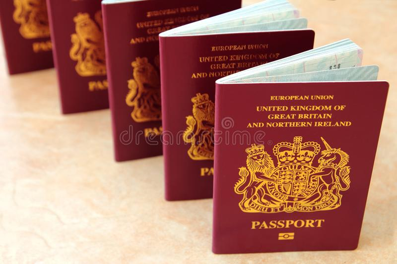 Five British United Kingdom European Union Biometric passports s stock photo