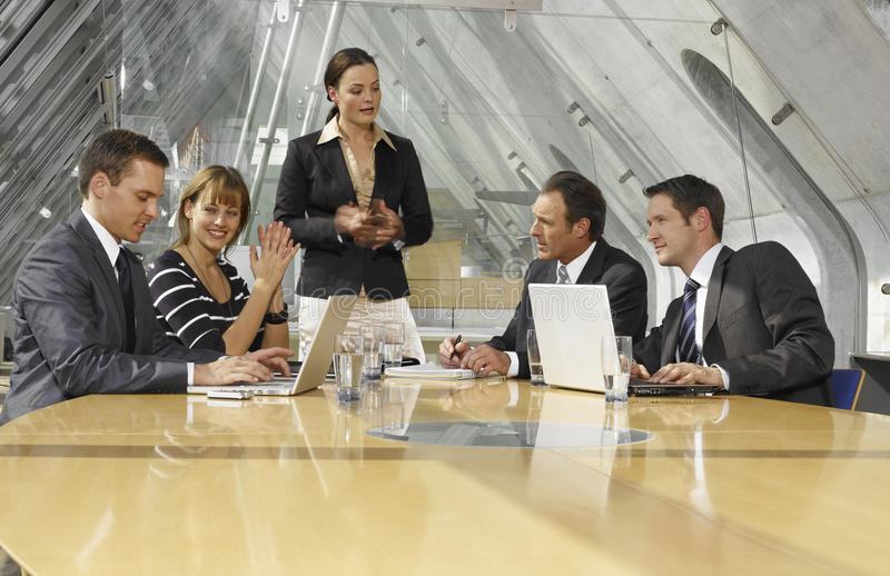 Five business executives in a boardroom.  stock photos