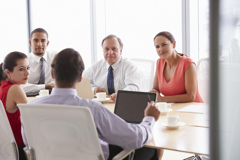 Five Businesspeople Having Meeting In Boardroom stock images
