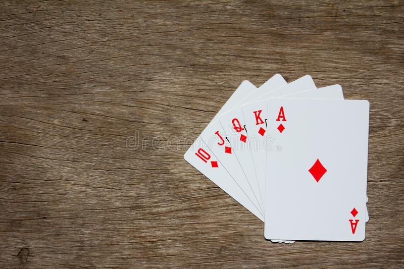 Five card of red diamond royal straight flush on wood background stock photos