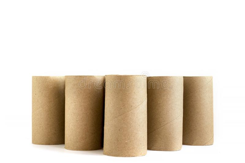 Five cardboard paper tubes on white background. Close-up of empty toilet rolls stock photo