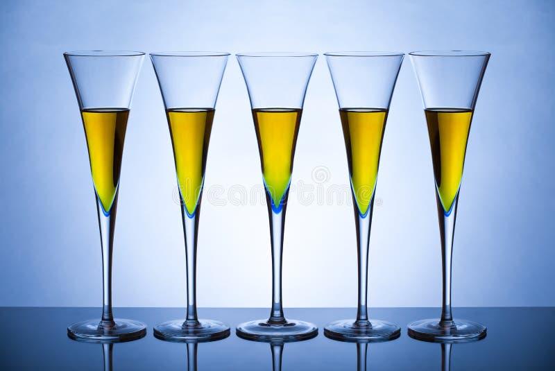Five champagne glasses stock photo
