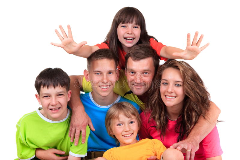 Five children with father. Five children wearing colorful tee shirts with father isolated against a white background royalty free stock photos