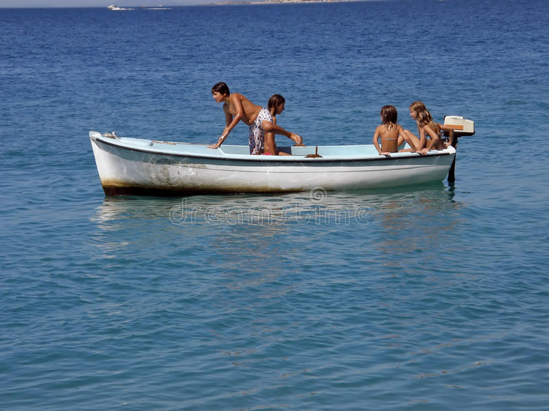 Download Five Children In Fun On Boat At Sea Stock Photo - Image: 12635876