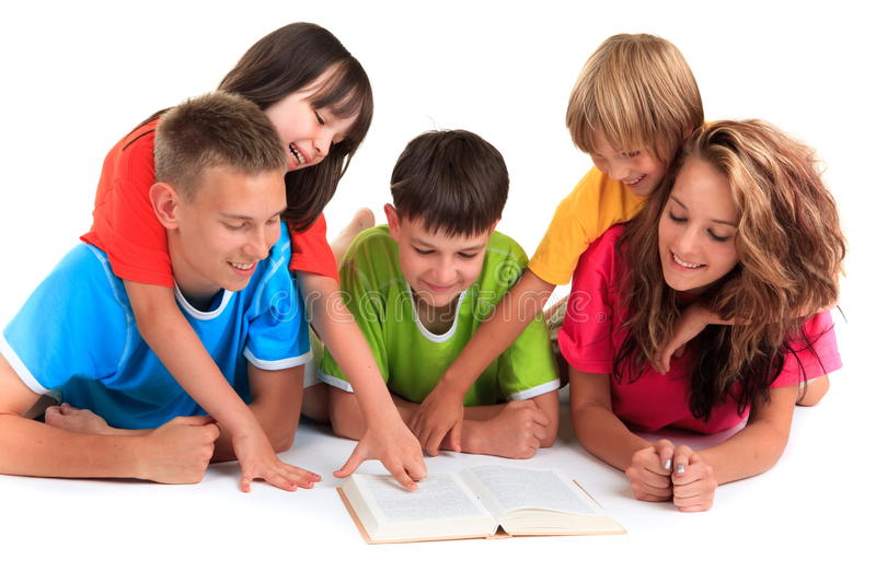 Five children reading a book stock photography