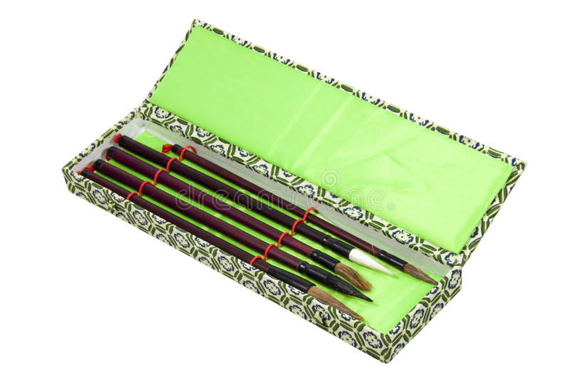 Five Chinese Calligraphy Brushes in Ornamental Box royalty free stock image