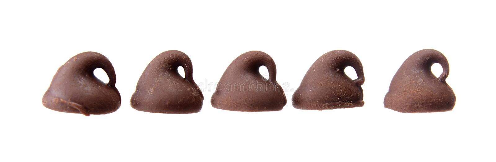 Five Chocolate Chips in a Row Isolated on White stock photo