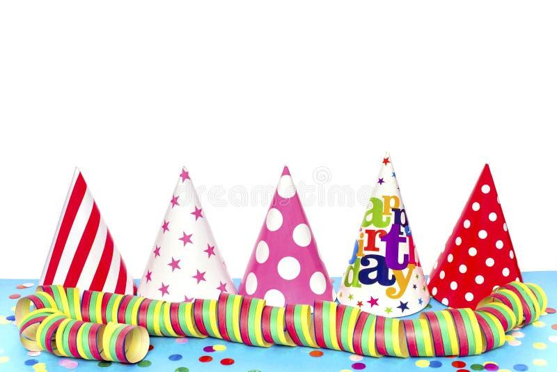 Five colorful hats. And confetti stock image