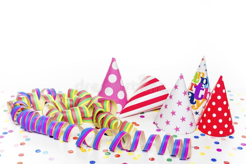 Five colorful hats. And confetti royalty free stock images