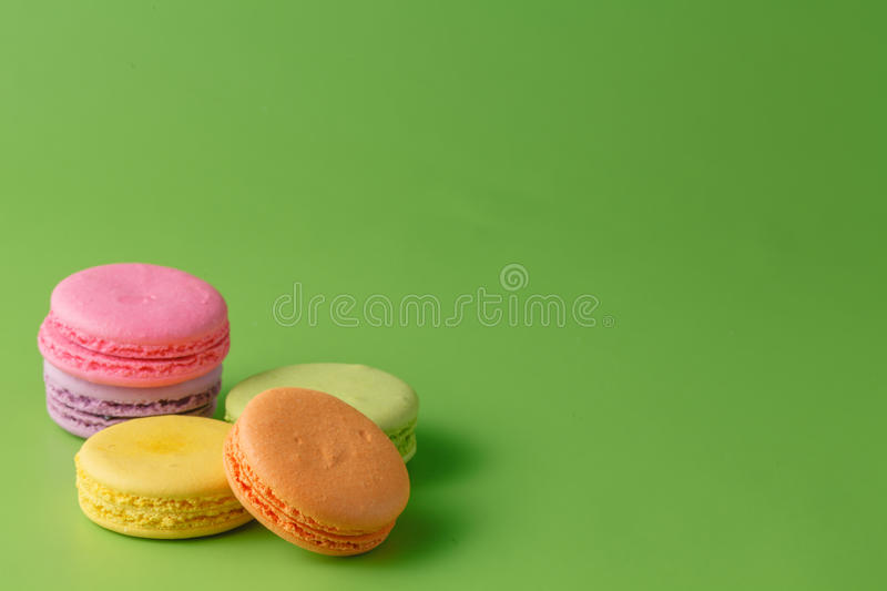 Five Colorful macaron on blue plain background stock photography
