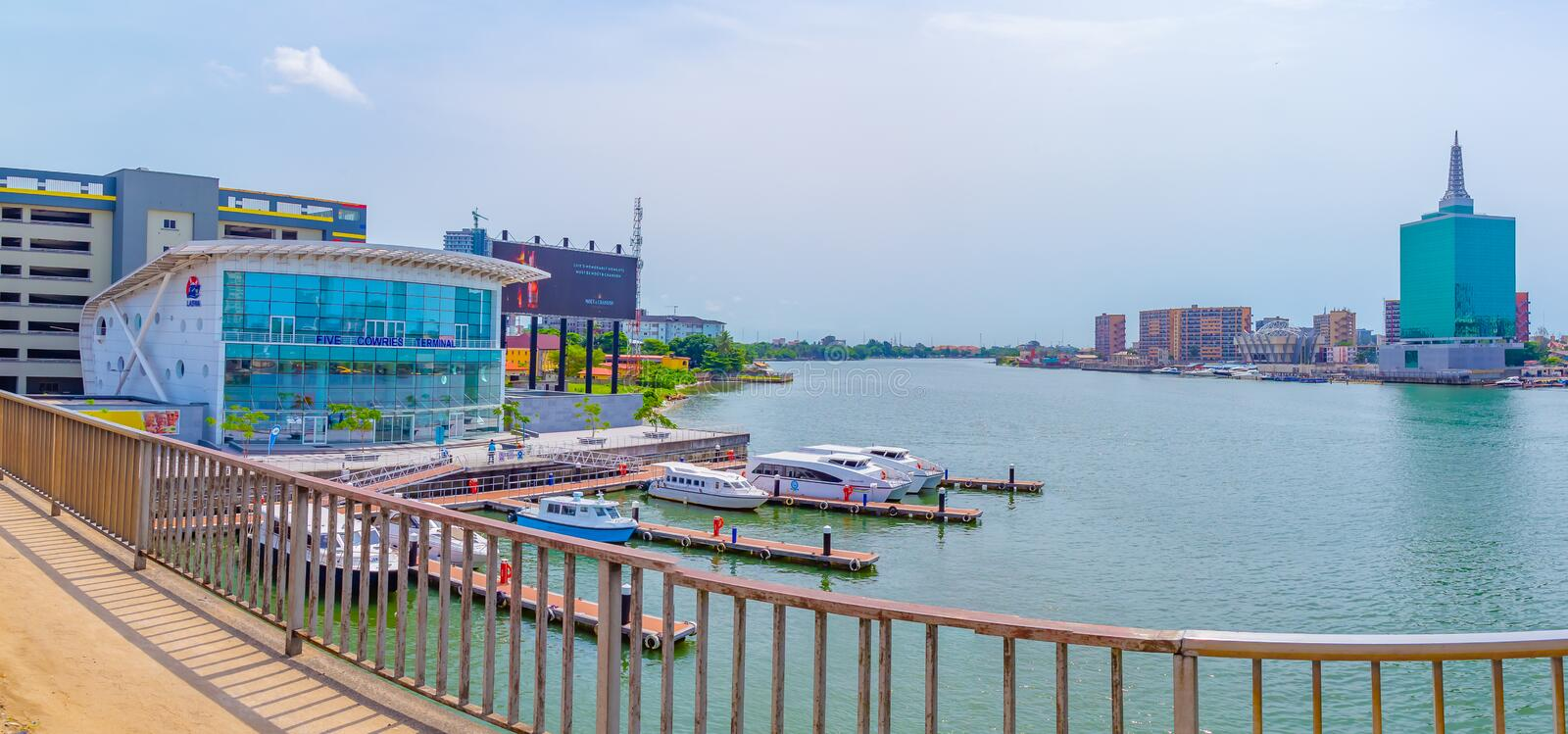 Panoramic view of Five Cowries Creek Lagos Nigeria. Five Cowries Creek is a portion of the Lagos lagoon which separates Ikoyi on the left in the photo from royalty free stock image