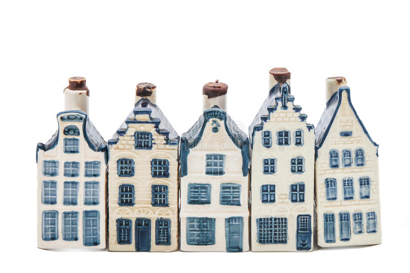 Five Delft blue houses. Row of five delft blue houses isolated on white royalty free stock image