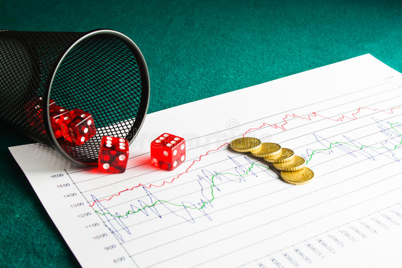 Five dice and coins on financial chart stock images