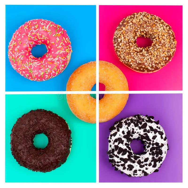 Five different donuts on bright multicolored background top view stock photos