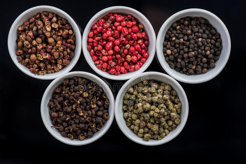 Five different pepper seeds in pots, stock photos
