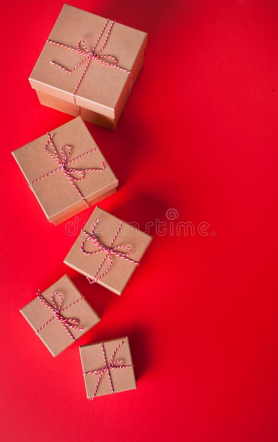 Five different sizes Christmas gift boxes on the red background.  stock photos