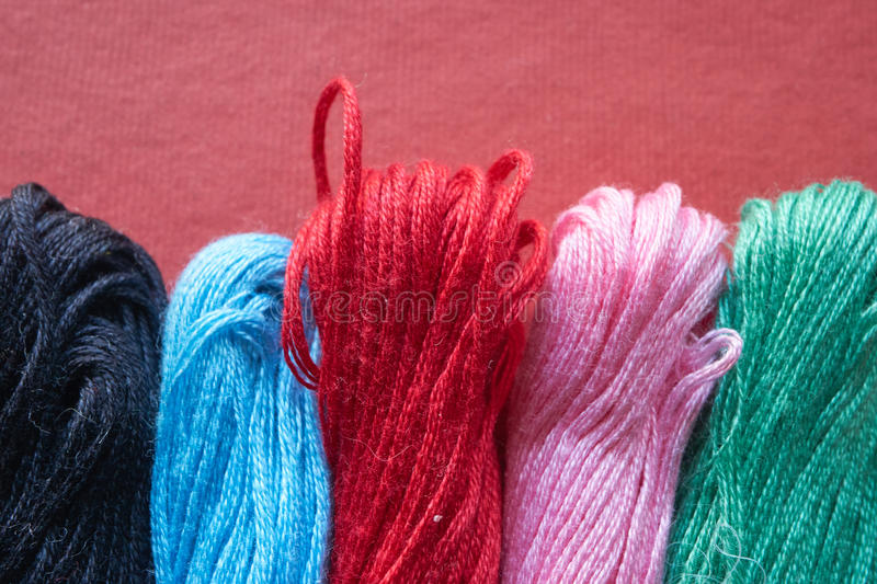 Five different skeins of threads royalty free stock photos