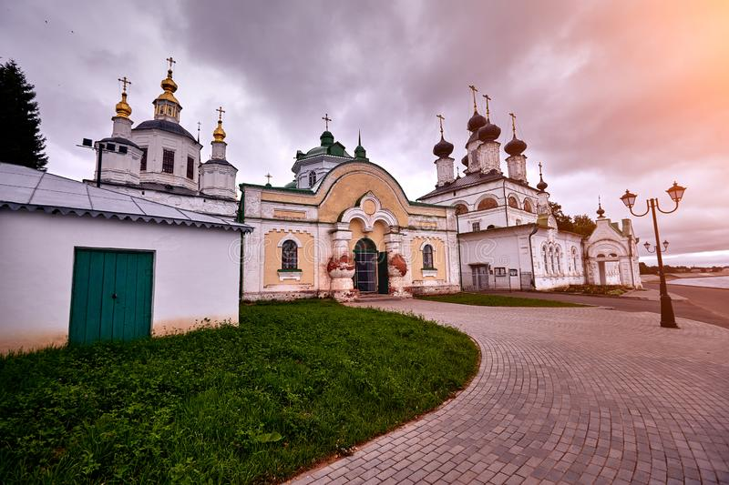 Five-domed russian orthodox church with a bell tower. Five-domed russian orthodox church with a bell tower, blue sky with clouds. Sun flare royalty free stock photo