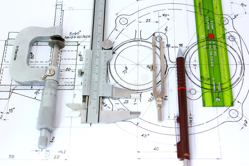Five engineering tools on blueprint stock photography