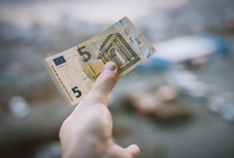 Five euro in hand. stock photo