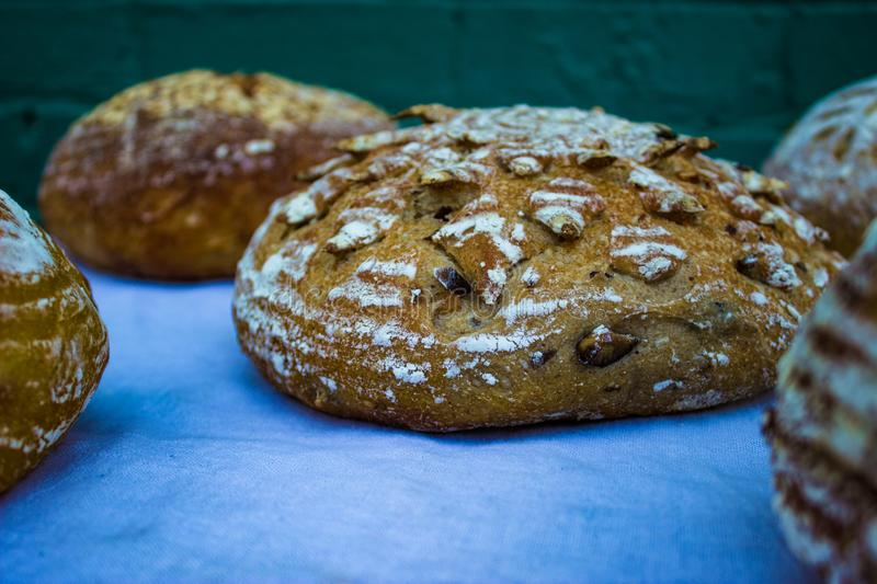 Fancy loaves of bread on table royalty free stock photo