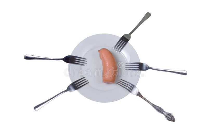 Five forks and a sausage. On a plate royalty free stock images