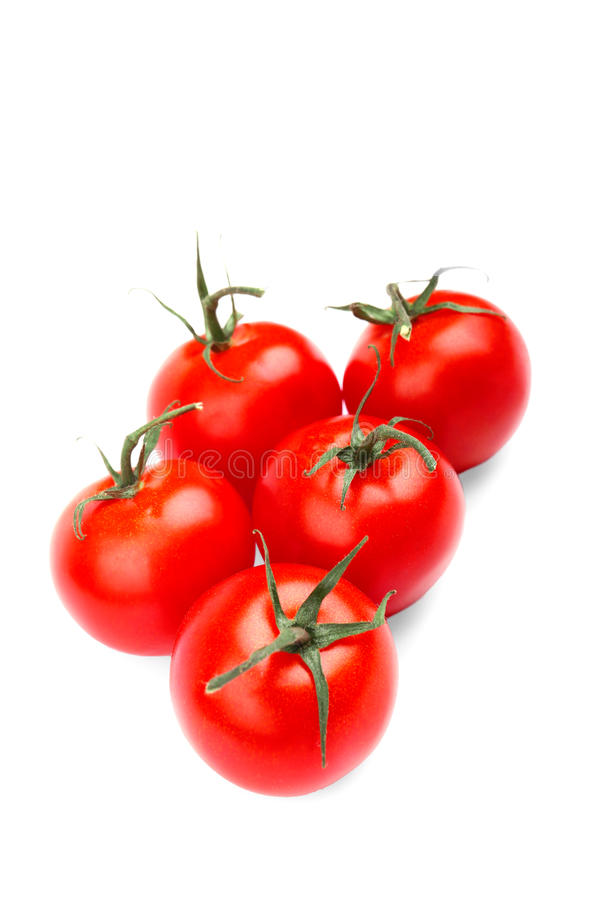 Five a fresh, juicy, healthful bright red tomatoes, on a white background. stock images
