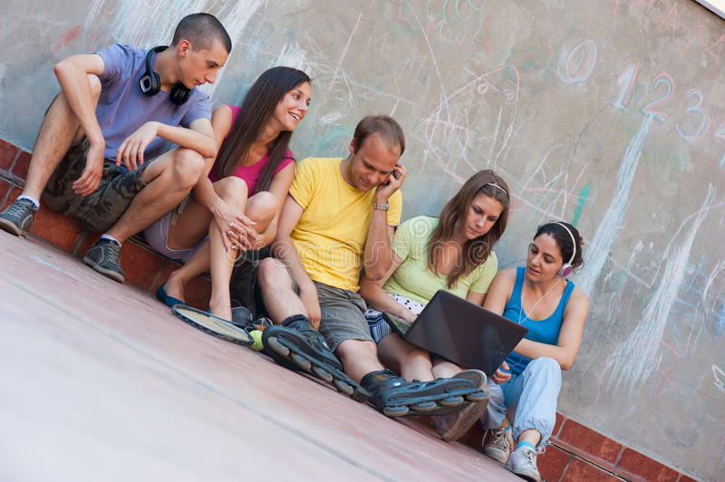 Download Five friends outdoor stock image. Image of playful, laptop - 25589319