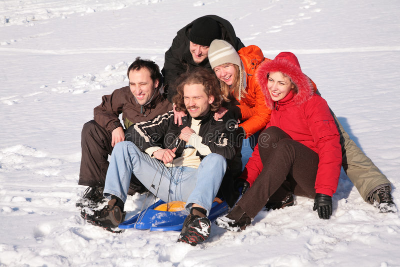 Download Five Friends With Plastic Sled Sit Stock Photo - Image: 4386864