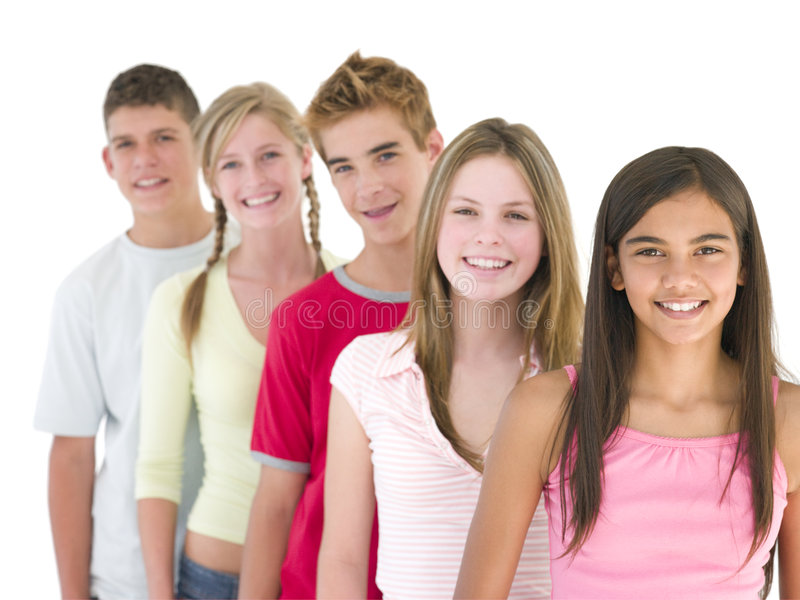 Five friends in a row smiling stock photography