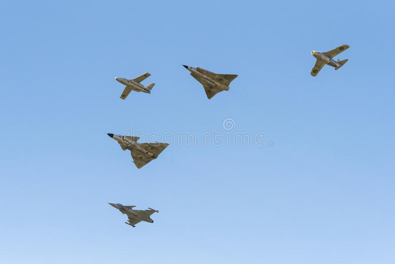 Five generations of SAAB military aircrafts in formation. Five generations of SAAB military aircrafts in arrow formation during air show at Malmen air base royalty free stock photo