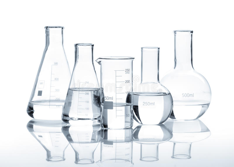 Five glass flasks with a clear liquid stock photos