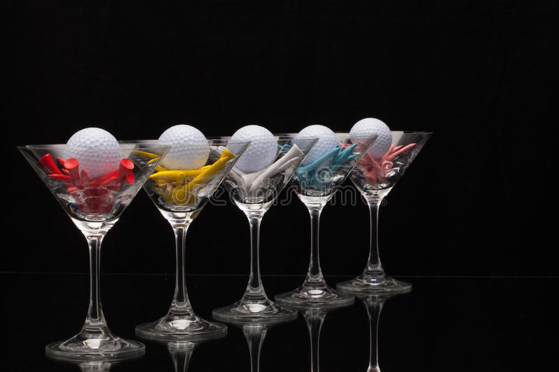 Five glasses of champagne and different golf tees stock photography