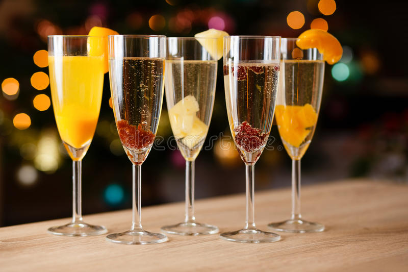 Five glasses of champagne with fruit royalty free stock photography