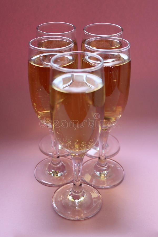Five glasses of sparkling champagne royalty free stock images
