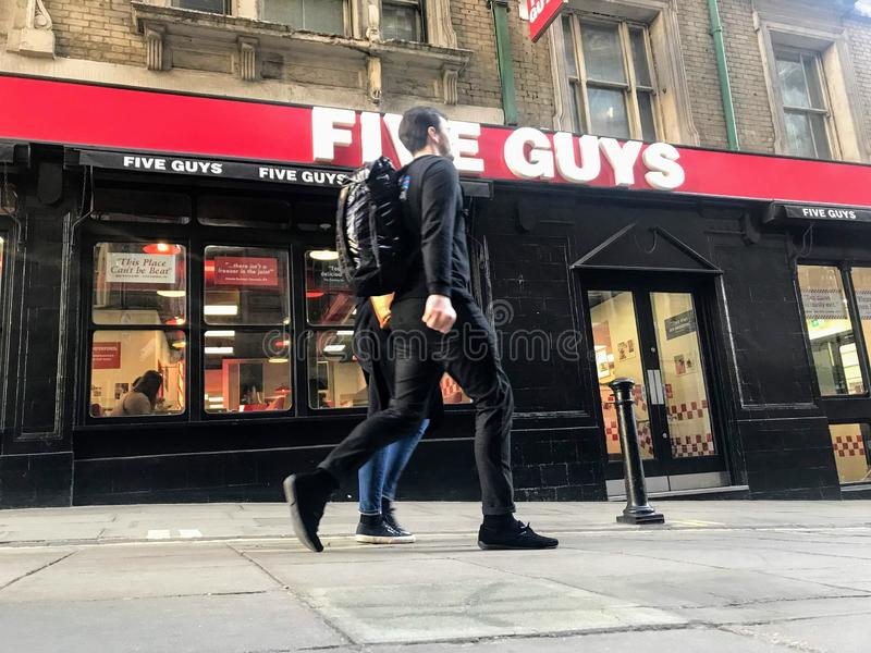 Five Guys restaurant at central London stock images
