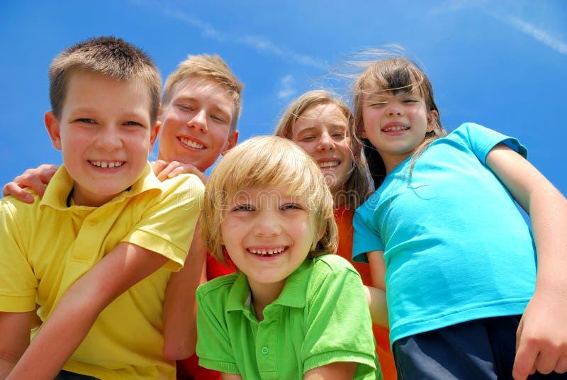 Five happy kids stock photos