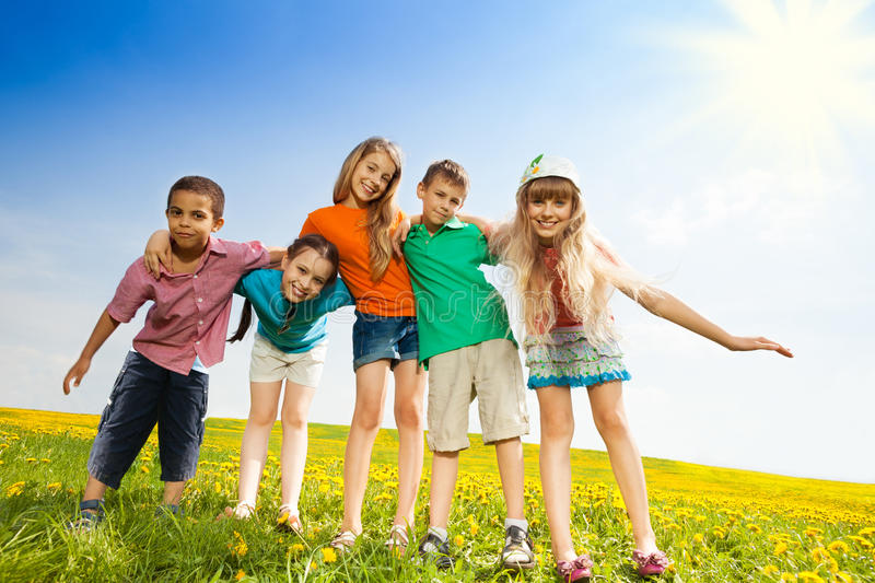 Five happy kids in the park stock photography