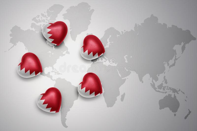 five hearts with national flag of bahrain on a world map background royalty free illustration